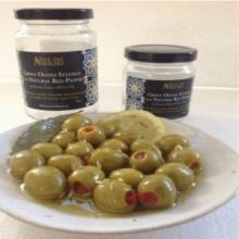 Green olives stuffed with natural red pepper in extra virgin olive oil